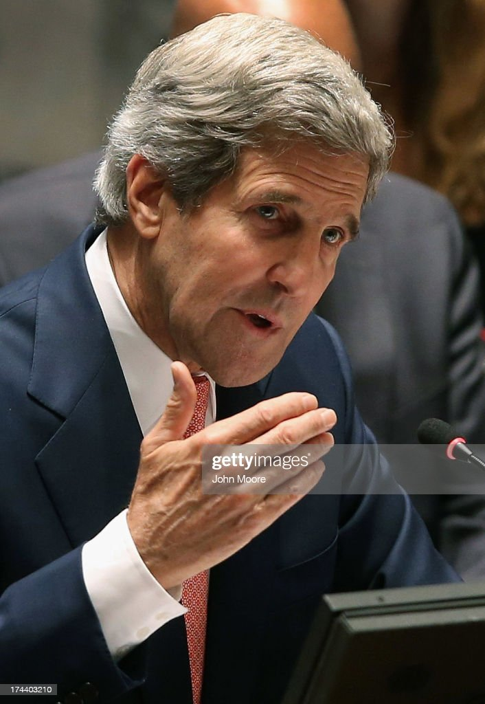 U.S. Secretary of State <a gi-track='captionPersonalityLinkClicked' href=/galleries/search?phrase=John+Kerry&family=editorial&specificpeople=154885 ng-click='$event.stopPropagation()'>John Kerry</a> presides over a meeting of the UN Security Council on July 25, 2013 in New York City. Kerry expressed American support for the UN's Peace, Security and Cooperation Framework for the Democratic Republic of the Congo and the region.