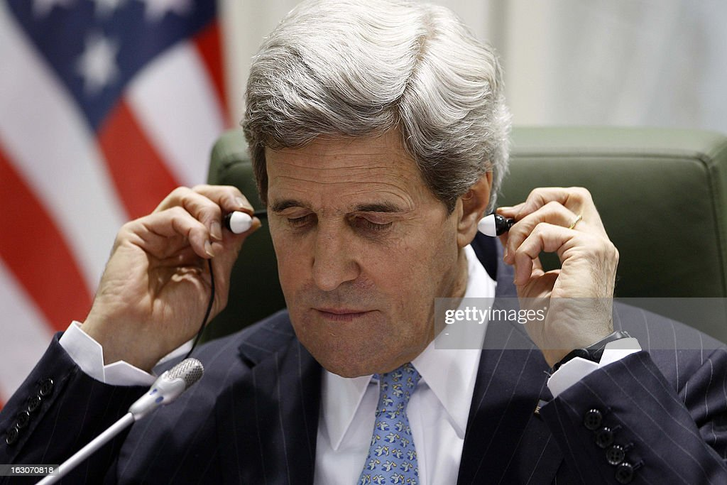 U.S. Secretary of State John Kerry puts on his headphones during a press conference with his counterpart Saudi's Prince Saud al-Faisal at the press hall in the Saudi Foreign Ministry in Riyadh, on March 4, 2013. Saudi Arabia is the seventh leg of Kerry's first official overseas trip.