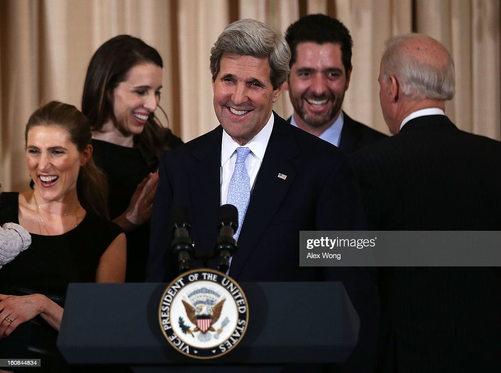 U.S. Secretary of State John Kerry (C) reacts after his ceremonial swearing in at the State Department February 6, 2013 in Washington, DC. Kerry was officially sworn in on February 1 at the U.S. Capitol as the 68th Secretary of State, succeeding Hillary Clinton.