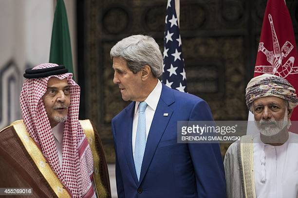 US Secretary of State John Kerry Saudi Foreign Minister Prince Saud alFaisal and Omani Foreign Minister Yussef bin Alawi bin Abdullah wait for a...