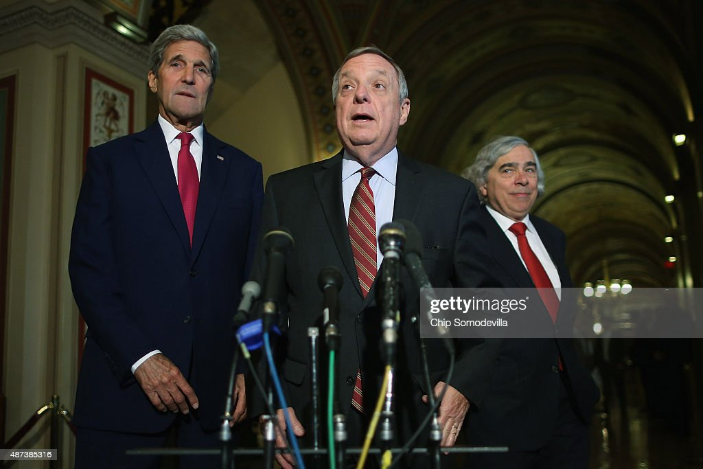 Secretary of State John Kerry, Senate Minority Whip Richard Durbin (D-IL) and U.S. Energy Secretary Ernest Moniz talk with reporters after meeting with members of Congress at the U.S. Capitol September 9, 2015 in Washington, DC. Moniz and Kerry briefed members of the House and Senate about the Syrian refugee crisis in Europe and the Iran nuclear deal.