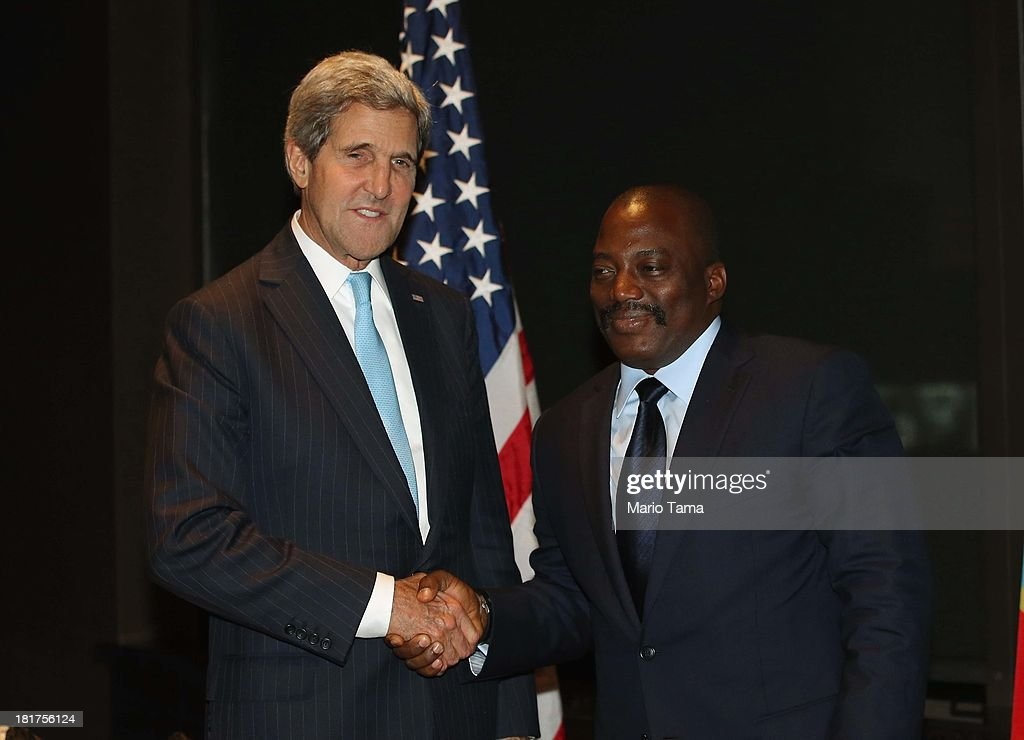 U.S. Secretary of State <a gi-track='captionPersonalityLinkClicked' href=/galleries/search?phrase=John+Kerry&family=editorial&specificpeople=154885 ng-click='$event.stopPropagation()'>John Kerry</a> (L) shakes hands at the start of a bilateral meeting with President <a gi-track='captionPersonalityLinkClicked' href=/galleries/search?phrase=Joseph+Kabila&family=editorial&specificpeople=467567 ng-click='$event.stopPropagation()'>Joseph Kabila</a> of the Democratic Republic of Congo on September 24, 2013 in New York City. Diplomats from around the world have descended on New York for the annual United Nations General Assembly.