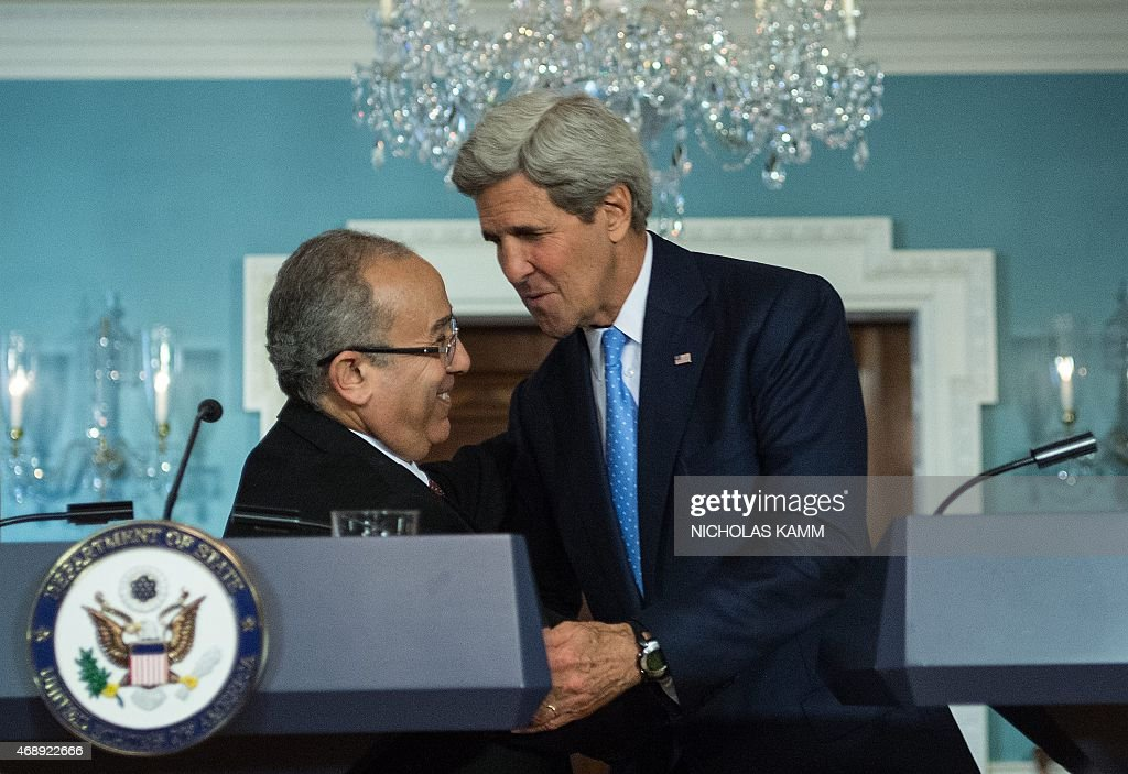 US Secretary of State <a gi-track='captionPersonalityLinkClicked' href=/galleries/search?phrase=John+Kerry&family=editorial&specificpeople=154885 ng-click='$event.stopPropagation()'>John Kerry</a> (R) shakes hands with Algerian Foreign Minister <a gi-track='captionPersonalityLinkClicked' href=/galleries/search?phrase=Ramtane+Lamamra&family=editorial&specificpeople=5486120 ng-click='$event.stopPropagation()'>Ramtane Lamamra</a> after a press conference as part of the US/ Algeria Strategic Dialogue at the State Department in Washington, DC on April 8, 2015. AFP PHOTO/ NICHOLAS KAMM