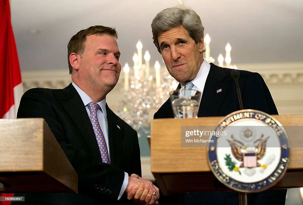 U.S. Secretary of State <a gi-track='captionPersonalityLinkClicked' href=/galleries/search?phrase=John+Kerry&family=editorial&specificpeople=154885 ng-click='$event.stopPropagation()'>John Kerry</a> (R) shakes hands with Canadian Foreign Minister John Baird (L) during a press conference after a bilateral meeting at the State Department February 8, 2013 in Washington, DC. Kerry said that the U.S. government continues to evaluate options to solve problematic relations with both the Syrian and Iranian governments.