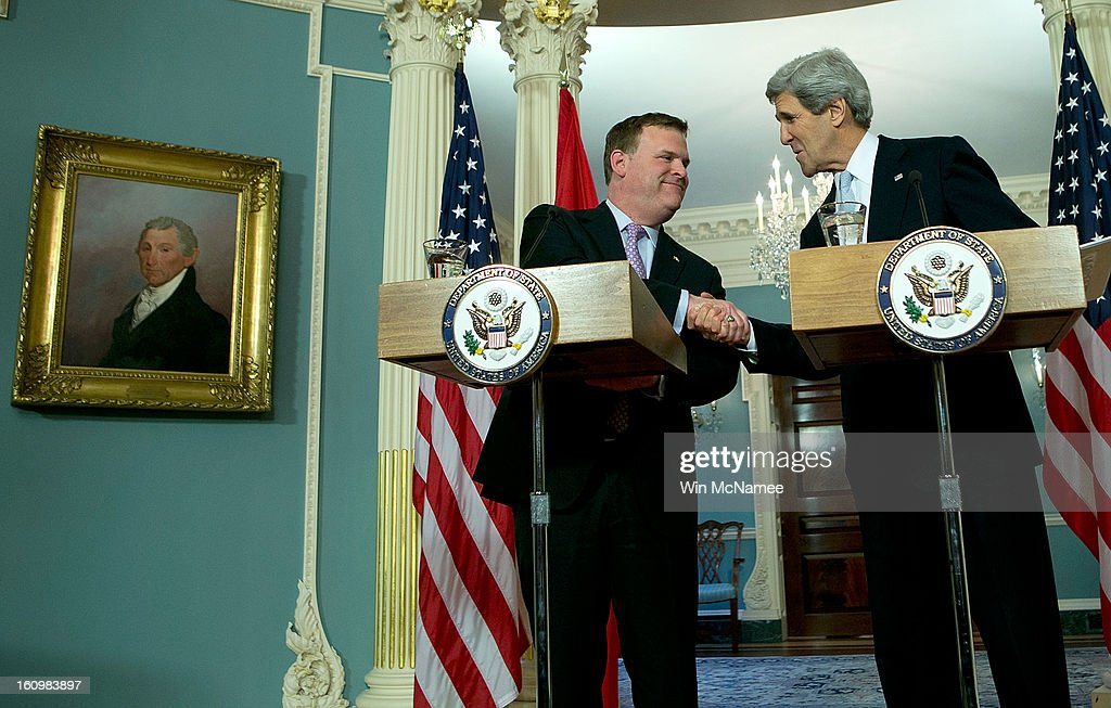 U.S. Secretary of State John Kerry (R) shakes hands with Canadian Foreign Minister John Baird (L) during a press conference after a bilateral meeting at the State Department February 8, 2013 in Washington, DC. Kerry said that the U.S. government continues to evaluate options to solve problematic relations with both the Syrian and Iranian governments.