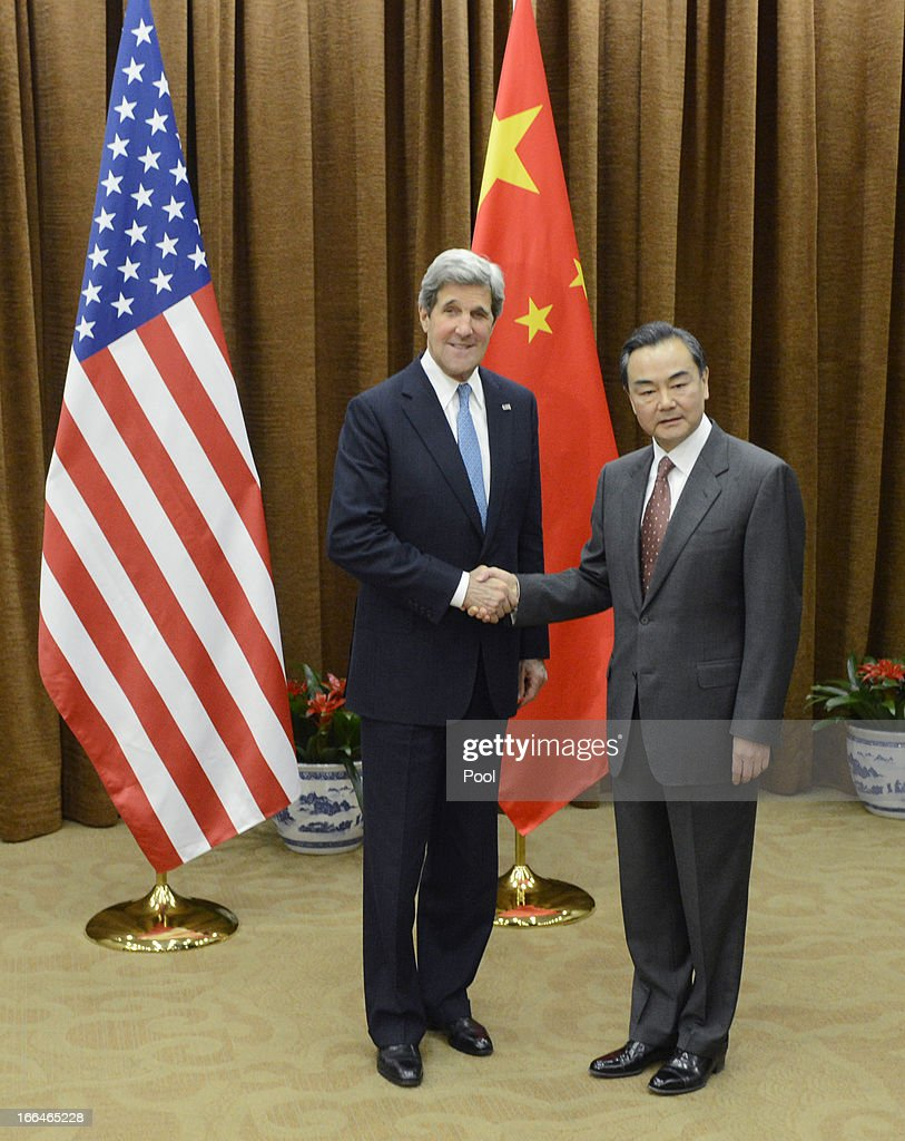 U.S. Secretary of State <a gi-track='captionPersonalityLinkClicked' href=/galleries/search?phrase=John+Kerry&family=editorial&specificpeople=154885 ng-click='$event.stopPropagation()'>John Kerry</a> (L) shakes hands with Chinese Foreign minister Wang Yi before a meeting at the Chinese Foreign Ministry in Beijing April 13, 2013. Kerry is on a tour of Asia, visiting South Korea, Japan and China to discuss issues concerning North Korea.