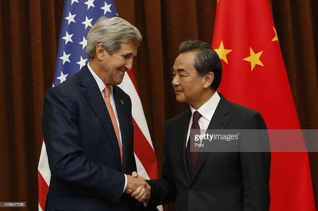 U.S. Secretary of State <a gi-track='captionPersonalityLinkClicked' href=/galleries/search?phrase=John+Kerry&family=editorial&specificpeople=154885 ng-click='$event.stopPropagation()'>John Kerry</a> (L) shakes hands with Chinese Foreign Minister <a gi-track='captionPersonalityLinkClicked' href=/galleries/search?phrase=Wang+Yi+-+Politician&family=editorial&specificpeople=13620429 ng-click='$event.stopPropagation()'>Wang Yi</a> prior to their meeting on May 16, 2015 in Beijing, China. Kerry was to meet Chinese leaders with State Department officials saying he would take a tough line over Beijing's island-building in strategic but disputed waters.