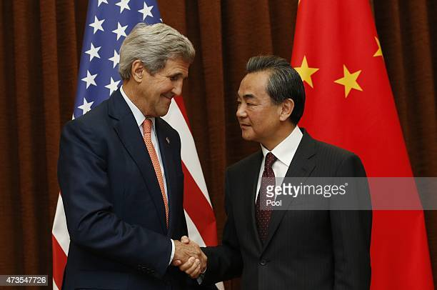 S Secretary of State John Kerry shakes hands with Chinese Foreign Minister Wang Yi prior to their meeting on May 16 2015 in Beijing China Kerry was...