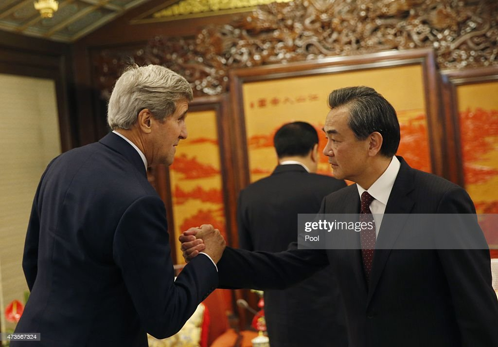 U.S. Secretary of State <a gi-track='captionPersonalityLinkClicked' href=/galleries/search?phrase=John+Kerry&family=editorial&specificpeople=154885 ng-click='$event.stopPropagation()'>John Kerry</a> (L) shakes hands with Chinese Foreign Minister <a gi-track='captionPersonalityLinkClicked' href=/galleries/search?phrase=Wang+Yi+-+Politician&family=editorial&specificpeople=13620429 ng-click='$event.stopPropagation()'>Wang Yi</a> as he meets Chinese Premier Li Keqiang (C) at the Zhongnanhai Leadership Compound on May 16, 2015 in Beijing, China. U.S. Secretary of State <a gi-track='captionPersonalityLinkClicked' href=/galleries/search?phrase=John+Kerry&family=editorial&specificpeople=154885 ng-click='$event.stopPropagation()'>John Kerry</a> is urging China to halt increasingly assertive actions it is taking in the South China Sea.