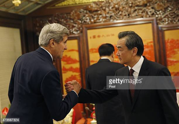 S Secretary of State John Kerry shakes hands with Chinese Foreign Minister Wang Yi as he meets Chinese Premier Li Keqiang at the Zhongnanhai...