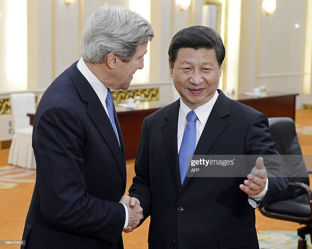 US Secretary of State John Kerry (L) shakes hands with Chinese President Xi Jinping before their meeting at the Great Hall of the People in Beijing on April 13, 2013. The current situation on the Korean peninsula is at a 'critical time', US Secretary of State John Kerry told Chinese President Xi Jinping on April 13 as he arrived to seek Beijing's intervention in the crisis. AFP PHOTO / POOL / YOHSUKE MIZUNO