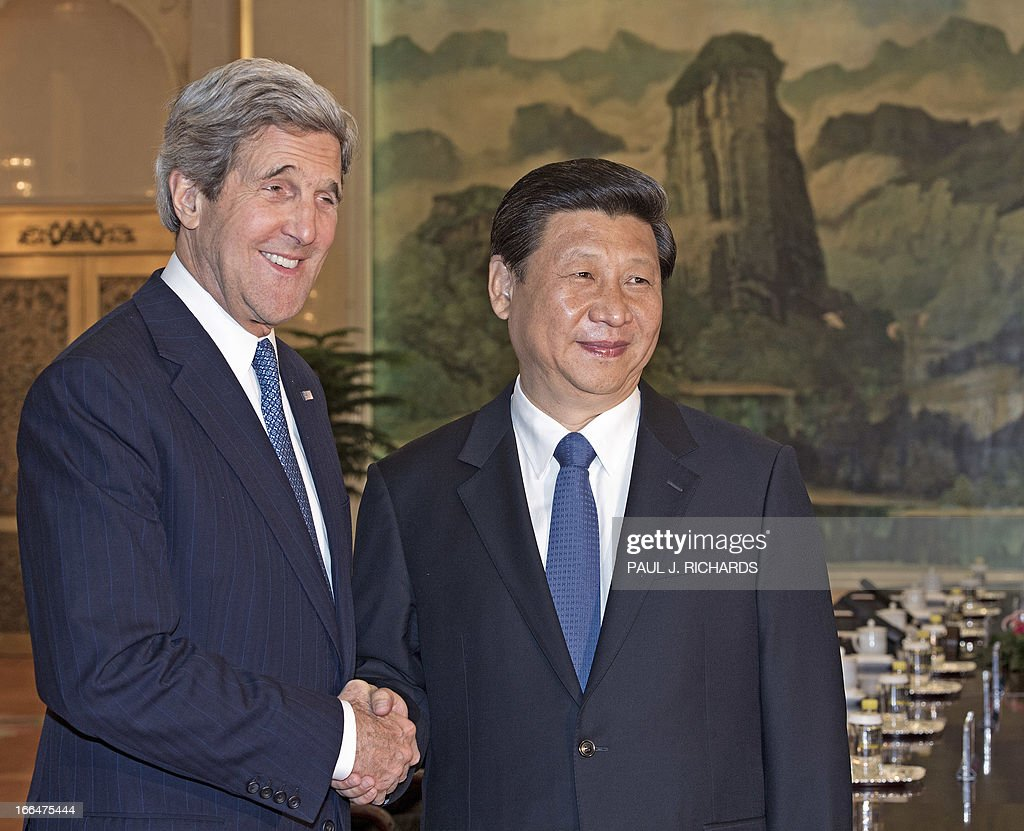 US Secretary of State John Kerry (L) shakes hands with Chinese President Xi Jinping before their meeting at the Great Hall of the People in Beijing on April 13, 2013. The current situation on the Korean peninsula is at a 'critical time', US Secretary of State John Kerry told Chinese President Xi Jinping on April 13 as he arrived to seek Beijing's intervention in the crisis. AFP PHOTO / POOL /Paul J. Richards