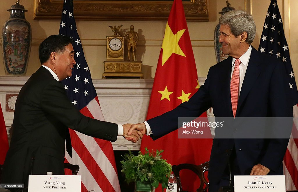 U.S. Secretary of State <a gi-track='captionPersonalityLinkClicked' href=/galleries/search?phrase=John+Kerry&family=editorial&specificpeople=154885 ng-click='$event.stopPropagation()'>John Kerry</a> (R) shakes hands with Chinese Vice Premier <a gi-track='captionPersonalityLinkClicked' href=/galleries/search?phrase=Wang+Yang+-+Politician&family=editorial&specificpeople=9984662 ng-click='$event.stopPropagation()'>Wang Yang</a> (L) after closing statements June 24, 2015 at the Department of State in Washington, DC. Officials from the U.S. and China participated in the seventh annual U.S.-China Strategic and Economic Dialogue to discuss bilateral issues.