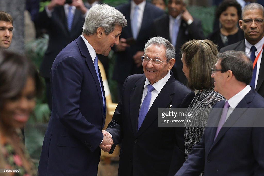 U.S. Secretary of State <a gi-track='captionPersonalityLinkClicked' href=/galleries/search?phrase=John+Kerry&family=editorial&specificpeople=154885 ng-click='$event.stopPropagation()'>John Kerry</a> (L) shakes hands with Cuban President Raul Castro during a state dinner at the Palace of the Revolution March 21, 2016 in Havana, Cuba. March 21, 2016 in Havana, Cuba. President Barack Obama is the first sitting U.S. president to visit Cuba in 88 years.
