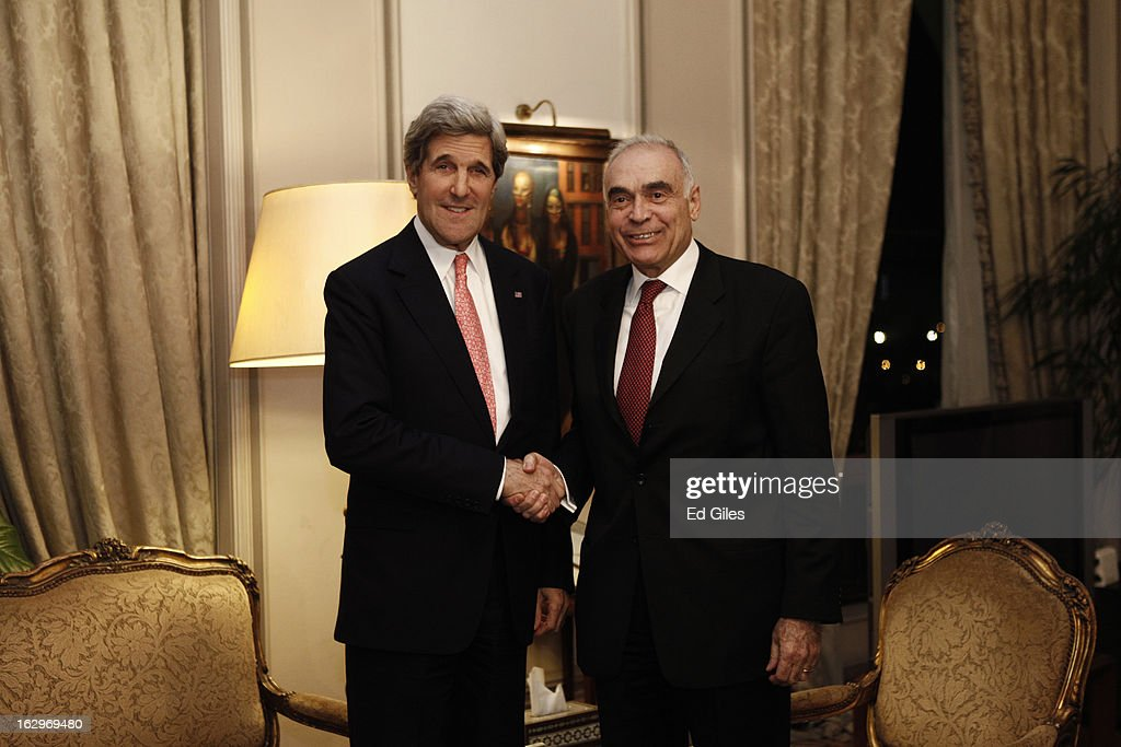 US Secretary of State <a gi-track='captionPersonalityLinkClicked' href=/galleries/search?phrase=John+Kerry&family=editorial&specificpeople=154885 ng-click='$event.stopPropagation()'>John Kerry</a> (L) shakes hands with Egyptian Foreign Minister Mohamed K. Amr during a meeting at the Egyptian Foreign Ministry on March 2, 2013 in Cairo, Egypt. Secretary of State Kerry is visiting Egypt for two days during an eleven country tour of Europe and the Middle East, marking the first overseas trip by Kerry since assuming the role of Secretary of State.