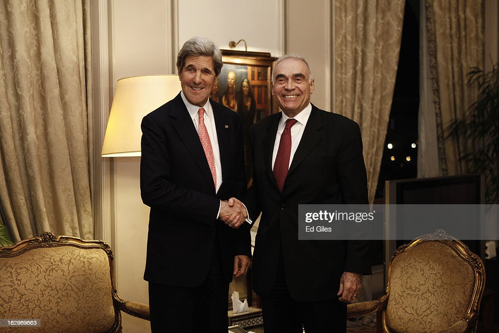US Secretary of State <a gi-track='captionPersonalityLinkClicked' href=/galleries/search?phrase=John+Kerry&family=editorial&specificpeople=154885 ng-click='$event.stopPropagation()'>John Kerry</a>, shakes hands with Egyptian Foreign Minister Mohamed K. Amr during a meeting at the Egyptian Foreign Ministry on March 2, 2013 in Cairo, Egypt. Secretary of State Kerry is visiting Egypt for two days during an eleven country tour of Europe and the Middle East, marking the first overseas trip by Kerry since assuming the role of Secretary of State.