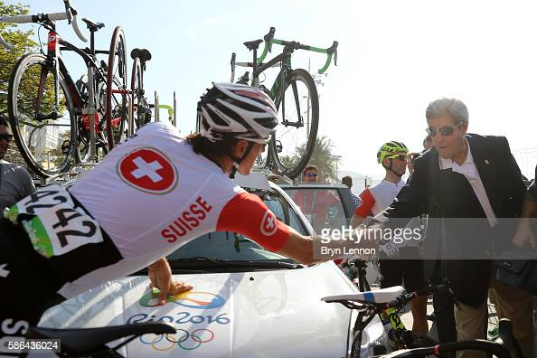 S Secretary of State John Kerry shakes hands with Fabian Cancellara of Switzerland before the Men's Road Race on Day 1 of the Rio 2016 Olympic Games...