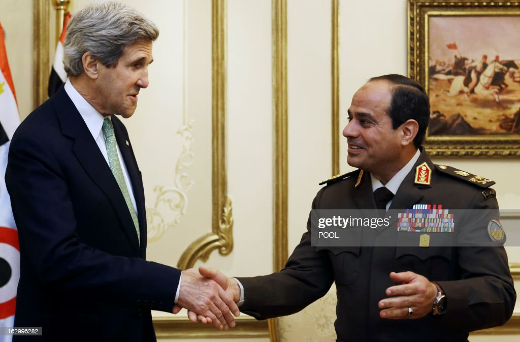 US Secretary of State John Kerry (L) shakes hands with General Abdel Fattah al-Sissi, Egyptian defence minister and commander of the armed forces, during a meeting at the defence ministry in Cairo on March 3, 2013. Kerry urged bickering Egyptian political leaders to forge a consensus to pave the way for aid that could help lift their country out of its deep economic crisis.