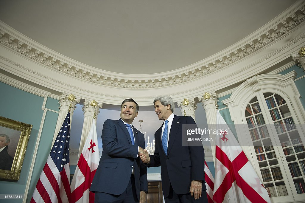 US Secretary of State John Kerry shakes hands with Georgian President Mikheil Saakashvili at the State Department in Washington, DC, on May 1, 2013. AFP PHOTO/JIM WATSON