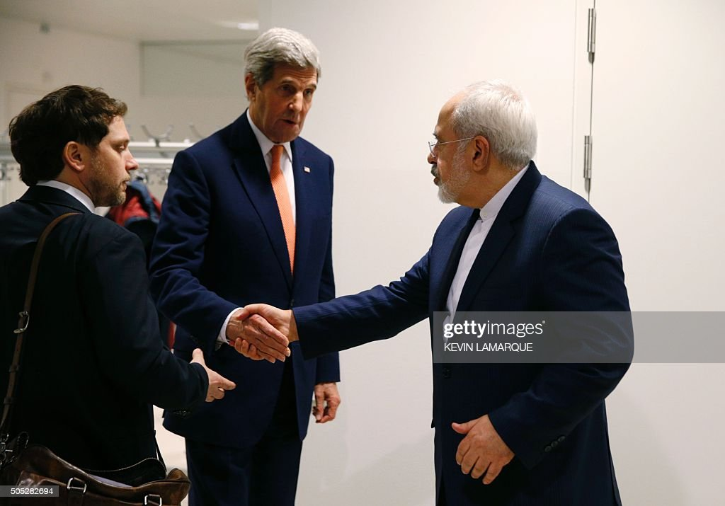 US Secretary of State John Kerry shakes hands with Iranian Foreign Minister Mohammad Javad Zarif after the International Atomic Energy Agency...