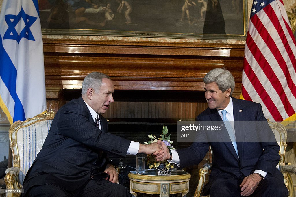 US Secretary of State John Kerry (R) shakes hands with Israeli Prime Minister Benjamin Netanyahu at Villa Taverna, the US Ambassador's residency in Rome, on October 23, 2013.