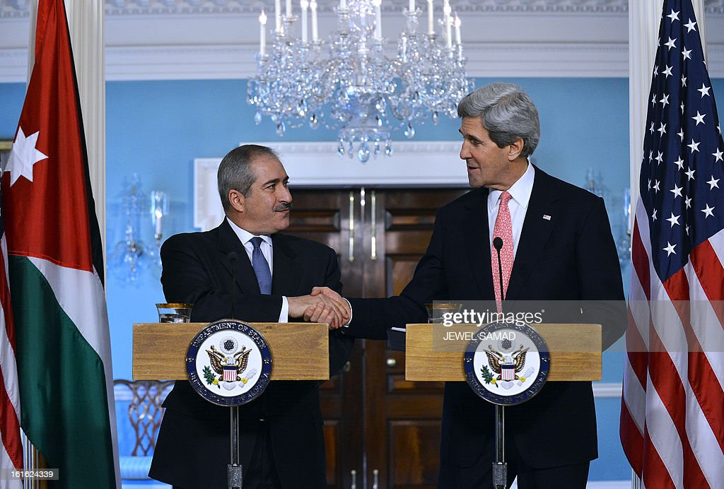US Secretary of State John Kerry shakes hands with Jordanian Foreign Minister Nasser Judeh (L) during a press briefing following their bilateral meeting at the Department of State in Washington, DC, on February 13, 2013. Kerry Wednesday urged 'strong, credible' response from world leaders after North Korea's nuclear test to show Iran that they are serious about non-proliferation. AFP PHOTO/Jewel Samad