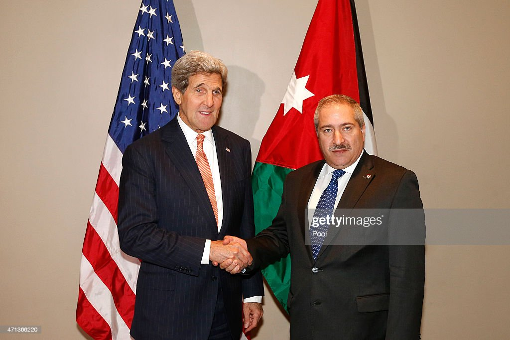 U.S. Secretary of State John Kerry (L) shakes hands with Jordanian Foreign Minister Nasser Judeh at United Nations headquarters April 27, 2015 In New York City. Kerry is at the UN to attend the U.N. anti-nuclear arms conference.