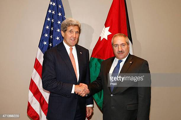 S Secretary of State John Kerry shakes hands with Jordanian Foreign Minister Nasser Judeh at United Nations headquarters April 27 2015 In New York...