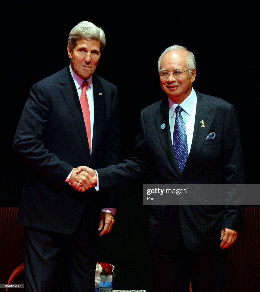 Secretary of State, <a gi-track='captionPersonalityLinkClicked' href=/galleries/search?phrase=John+Kerry&family=editorial&specificpeople=154885 ng-click='$event.stopPropagation()'>John Kerry</a> shakes hands with Malaysian Prime Minister, Najib Razak at the Global Entrepreneurship Summit on October 11, 2013 in Kuala Lumpur, Malaysia. Over 100 speakers and leaders from across the globe will address over 4,000 attendees of the 4th annual two-day summit. Summit founder, US President Barack Obama was scheduled to attend the event, but due to the US government shut-down, US Secretary of State <a gi-track='captionPersonalityLinkClicked' href=/galleries/search?phrase=John+Kerry&family=editorial&specificpeople=154885 ng-click='$event.stopPropagation()'>John Kerry</a>, is attending in his place.