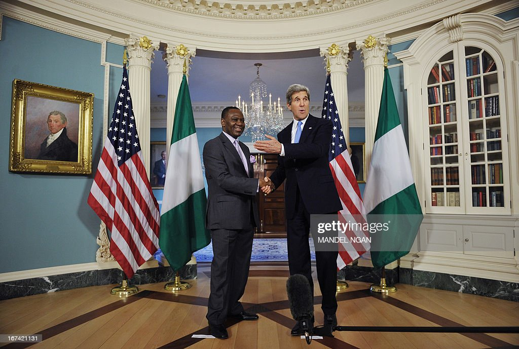 US Secretary of State John Kerry (R) shakes hands with Nigeria's Foreign Minister Olugbenga Ashiru ahead of a bilateral meeting on April25, 2013 at the State Department in Washington, DC. AFP PHOTO/Mandel NGAN