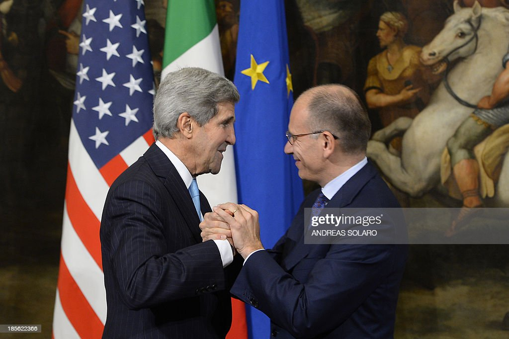 US secretary of State John Kerry (L) shakes hands with Prime Minister Enrico Letta before their meeting on October 23, 2013 at the Palazzo Chigi in Rome.