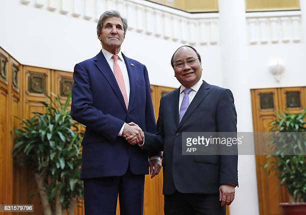 UX Secretary of State John Kerry shakes hands with Prime Minister Nguyen Xuan Phuc at the Office of the Government before their meeting in Hanoi on...