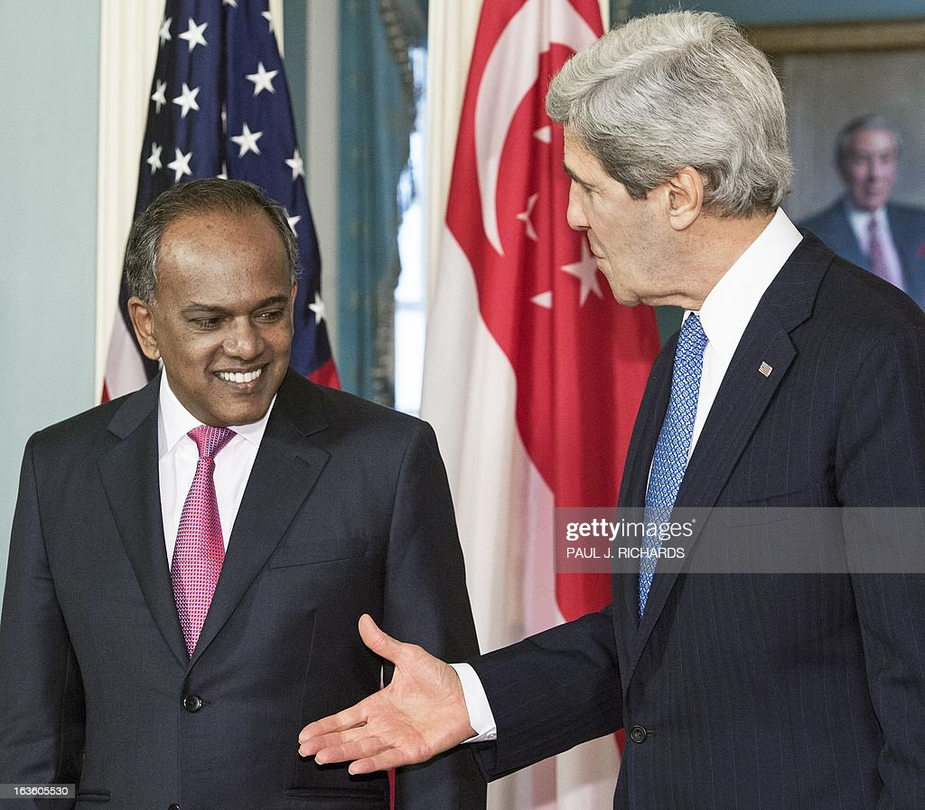 US Secretary of State John Kerry shakes hands with the Foreign Minister of Singapore K. Shanmugam (L) on March 13, 2013, at the US Department of State in Washington, DC. AFP Photo/Paul J. Richards