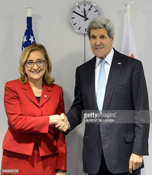 US Secretary of State John Kerry shakes hands with the new Georgian Foreign Minister Tamar Beruchashvili during a bilateral meeting after the opening...