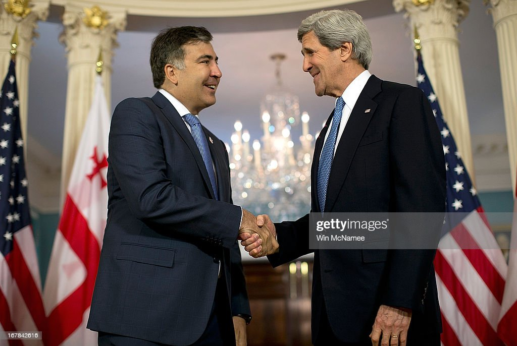 U.S. Secretary of State <a gi-track='captionPersonalityLinkClicked' href=/galleries/search?phrase=John+Kerry&family=editorial&specificpeople=154885 ng-click='$event.stopPropagation()'>John Kerry</a> (R) shakes hands with the President of Georgia Mikheil Saakashvili after speaking to journalists following a bilateral meeting at the U.S. State Department May 1, 2013 in Washington, DC. Kerry is scheduled to travel to Russia next week to discuss recent developments in the region.