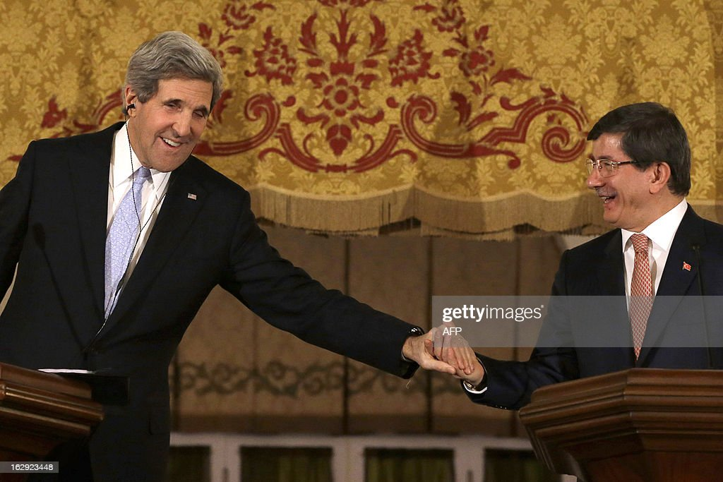 US Secretary of State John Kerry shakes hands with Turkish Foreign Minister Ahmet Davutoglu during a press conference at Cankaya Palace in Ankara, on March 1, 2013. Kerry held talks with Turkey's leaders on the Syria crisis today amid a row over comments by the Turkish premier branding Zionism a 'crime against humanity'. AFP PHOTO POOL JACQUELYN MARTIN