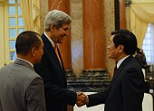 US Secretary of State John Kerry shakes hands with Vietnamese President Truong Tan Sang as they meet at the presidential palace in Hanoi on August 7...
