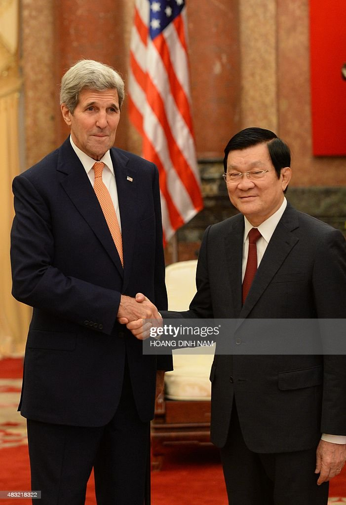 US Secretary of State John Kerry (L) shakes hands with Vietnamese President Truong Tan Sang as they meet at the presidential palace in Hanoi on August 7, 2015. Kerry met top communist party leaders in Hanoi and hailed the former foes' transformation from enemies to key allies in the two decades since ties were established.