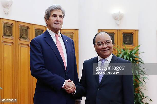 US Secretary of State John Kerry shakes hands with Vietnam's Prime Minister Nguyen Xuan Phuc at the Government Office in Hanoi on January 13 2017...