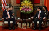 US Secretary of State John Kerry shakes sits talking with Vietnamese President Truong Tan Sang as they meet at the presidential palace in Hanoi on...