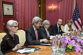 US Secretary of State John Kerry sits at the negotiating table with US Under Secretary for Political Affairs Wendy Sherman US Secretary of Energy...
