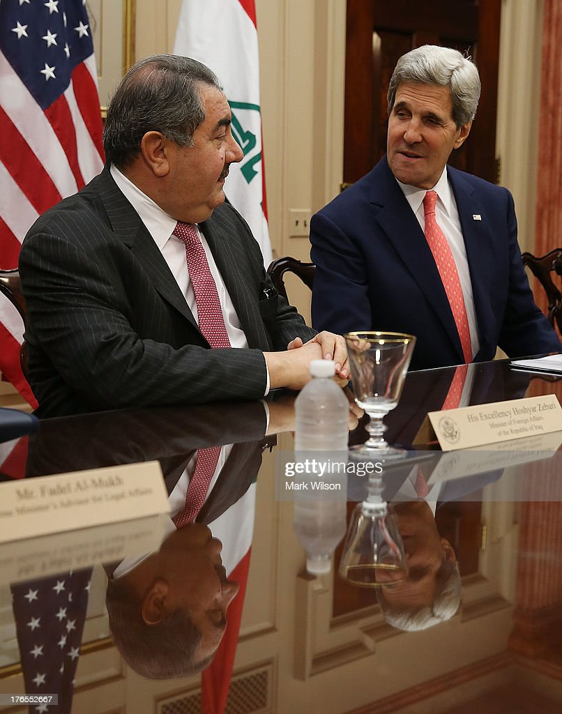 Secretary of State <a gi-track='captionPersonalityLinkClicked' href=/galleries/search?phrase=John+Kerry&family=editorial&specificpeople=154885 ng-click='$event.stopPropagation()'>John Kerry</a> (R) sits with Iraqi Foreign Minister <a gi-track='captionPersonalityLinkClicked' href=/galleries/search?phrase=Hoshyar+Zebari&family=editorial&specificpeople=227333 ng-click='$event.stopPropagation()'>Hoshyar Zebari</a> during a meeting at the State Department August 15, 2013 in Washington, DC. Secretary Kerry spoke during the U.S.-Iraq Diplomatic and Political Joint Coordinating Committee meeting.