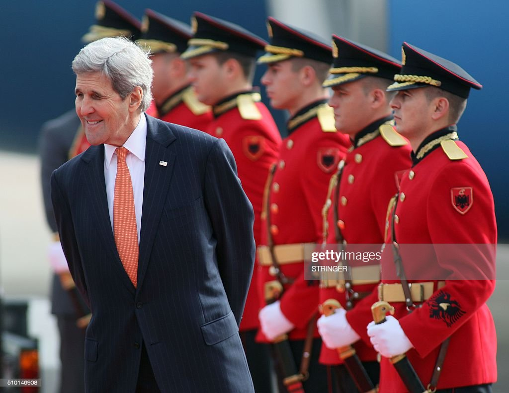 US Secretary of State John Kerry smiles during a welcoming ceremony upon his arrival at Mother Teresa airport in Tirana on February 14, 2016. US Secretary of State is in a few hours visit to Tirana, to meet with senior government leaders to discuss Albania's further Euro-Atlantic integration and strong bilateral cooperation with the United States. / AFP / STRINGER