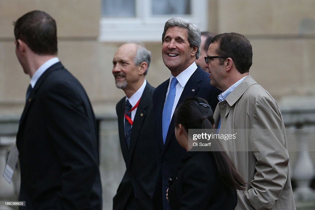 US Secretary of State John Kerry (C) smiles with colleagues as he arrives at Lancaster House on April 11, 2013 in London, England. G8 Foreign Ministers are holding a two day meeting where they will discuss the situation in the Middle East; including Syria and Iran, security and stability across North and West Africa, Democratic People's Republic of Korea and climate change. British Foreign Secretary William Hague will also highlight five key policy priorities.
