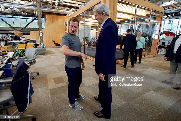 US Secretary of State John Kerry speaking with Facebook CEO Mark Zuckerberg at Facebook headquarters Menlo Park California 2016 Image courtesy US...