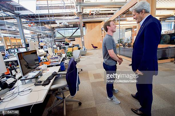 US Secretary of State John Kerry speaking with Facebook CEO Mark Zuckerberg at Facebook headquarters Menlo Park California June 23 2016 Image...