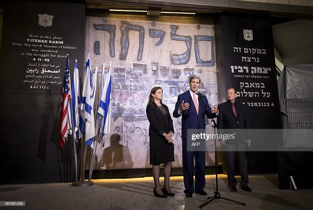 U.S. Secretary of State John Kerry speaks alongside Dalia Rabin-Pelossof (L), daughter of assassinated Israeli Prime Minister Yitzhak Rabin and Tel Aviv Mayor Ron Huldai at the site of Rabin's death after a wreath laying ceremony in Tel Aviv, on November 5, 2013. Rabin was assassinated nearby on November 4, 1995. AFP PHOTO/JASON REED/POOL