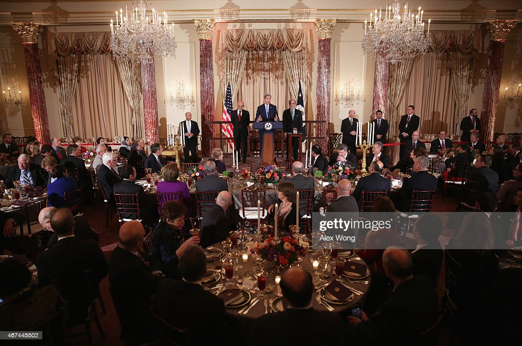 U.S. Secretary of State <a gi-track='captionPersonalityLinkClicked' href=/galleries/search?phrase=John+Kerry&family=editorial&specificpeople=154885 ng-click='$event.stopPropagation()'>John Kerry</a> (C) speaks as Afghanistan President <a gi-track='captionPersonalityLinkClicked' href=/galleries/search?phrase=Ashraf+Ghani&family=editorial&specificpeople=2085543 ng-click='$event.stopPropagation()'>Ashraf Ghani</a> (L) and Afghanistan Chief Executie <a gi-track='captionPersonalityLinkClicked' href=/galleries/search?phrase=Abdullah+Abdullah&family=editorial&specificpeople=695346 ng-click='$event.stopPropagation()'>Abdullah Abdullah</a> (R) listen as they make remarks during a dinner hosted by Kerry at the State Department March 24, 2015 in Washington, DC. President Ghani and Chief Executive Abdullah are on a visit to the U.S.