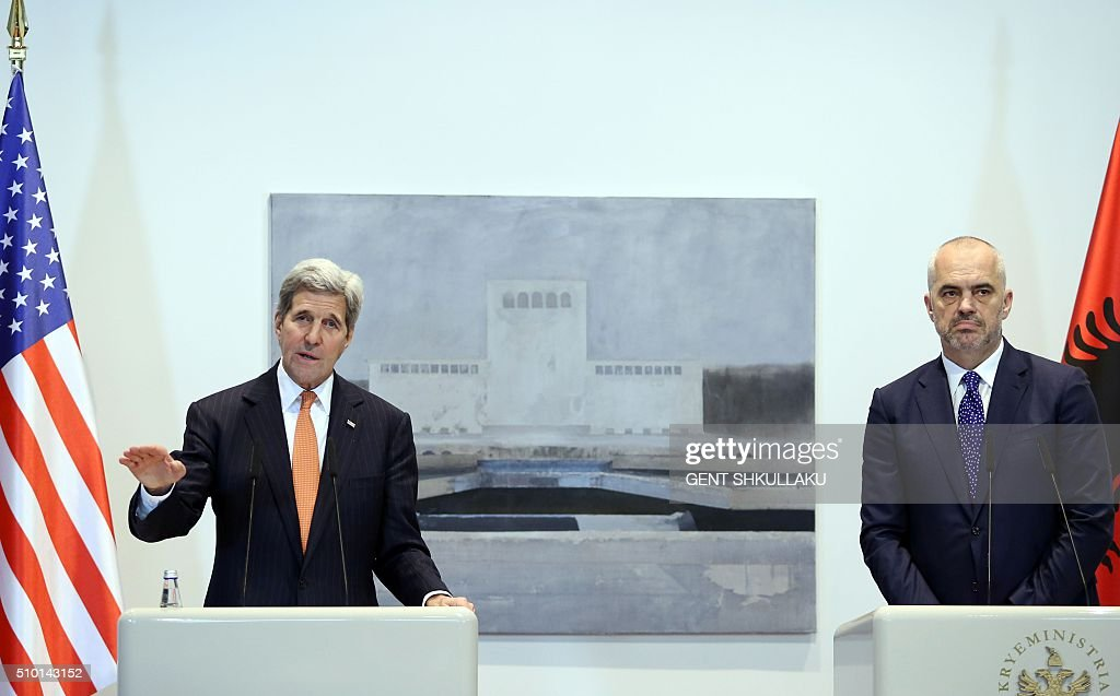 US Secretary of State John Kerry (L) speaks during a joint media statement with Albanian Prime Minister Edi Rama (R) in Tirana on February 14, 2016. US Secretary of State is in a few hours visit to Tirana, to meet with senior government leaders to discuss Albanias further Euro-Atlantic integration and strong bilateral cooperation with the United States. / AFP / GENT SHKULLAKU