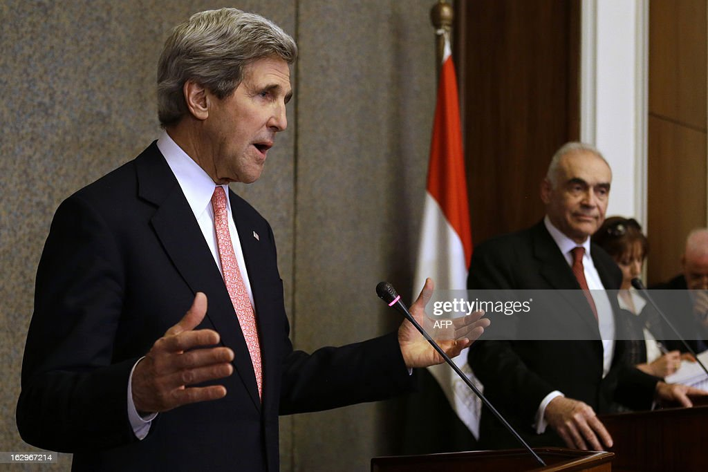US Secretary of State John Kerry speaks during a joint news conference with Egyptian Foreign Minister Mohammed Kamel Amr (R) at the foreign ministry in Cairo on March 2, 2013. Kerry is in Cairo to push for a way out of Egypt's violence-wracked political impasse, underlining the need for a consensus to overcome a crippling economic crisis. AFP PHOTO/POOL/JACQUELYN MARTIN
